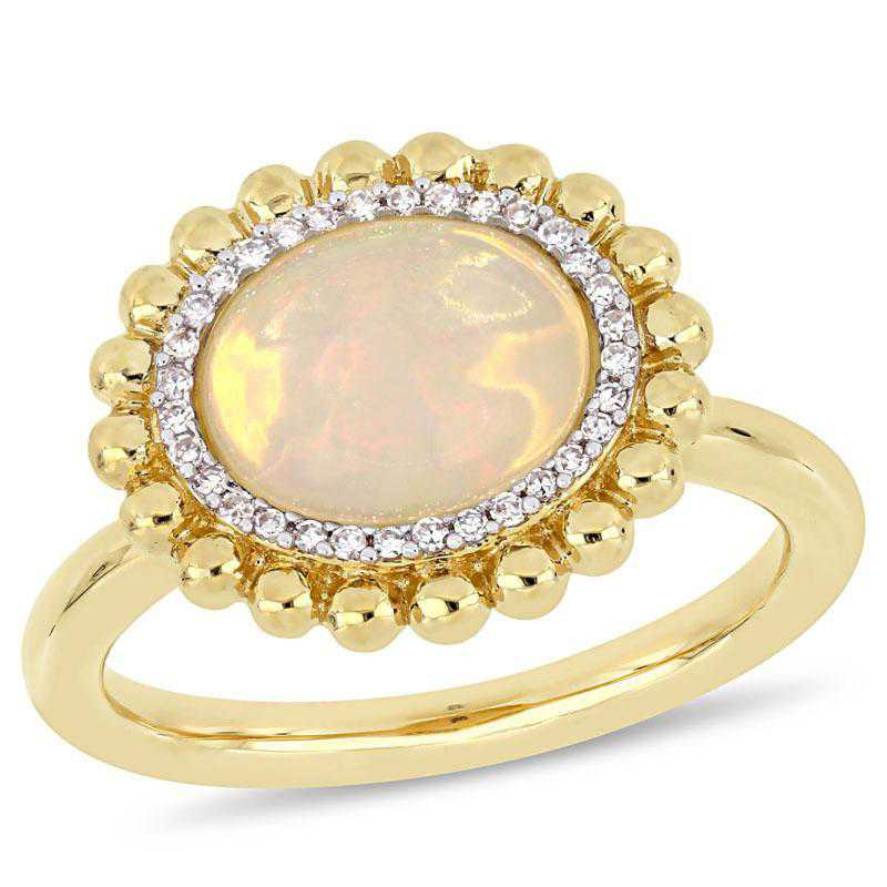 Oval-Cut Yellow Opal and 1/10 CT TW Diamond Halo Ring in 14k Yellow Gold